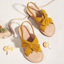 Sandalias de niñita de talon abierto con lazo