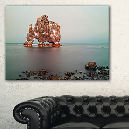 Designart Rock Sea Symbol In Iceland Canvas Art, One Size , Blue