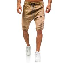 Shorts unicolor de hombres de cintura con cordon