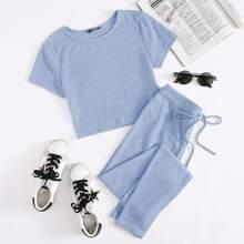 Conjunto camiseta tejida de canale con leggings de cintura con cordon