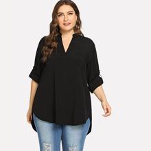 Einfarbige Bluse mit abfallendem Saum