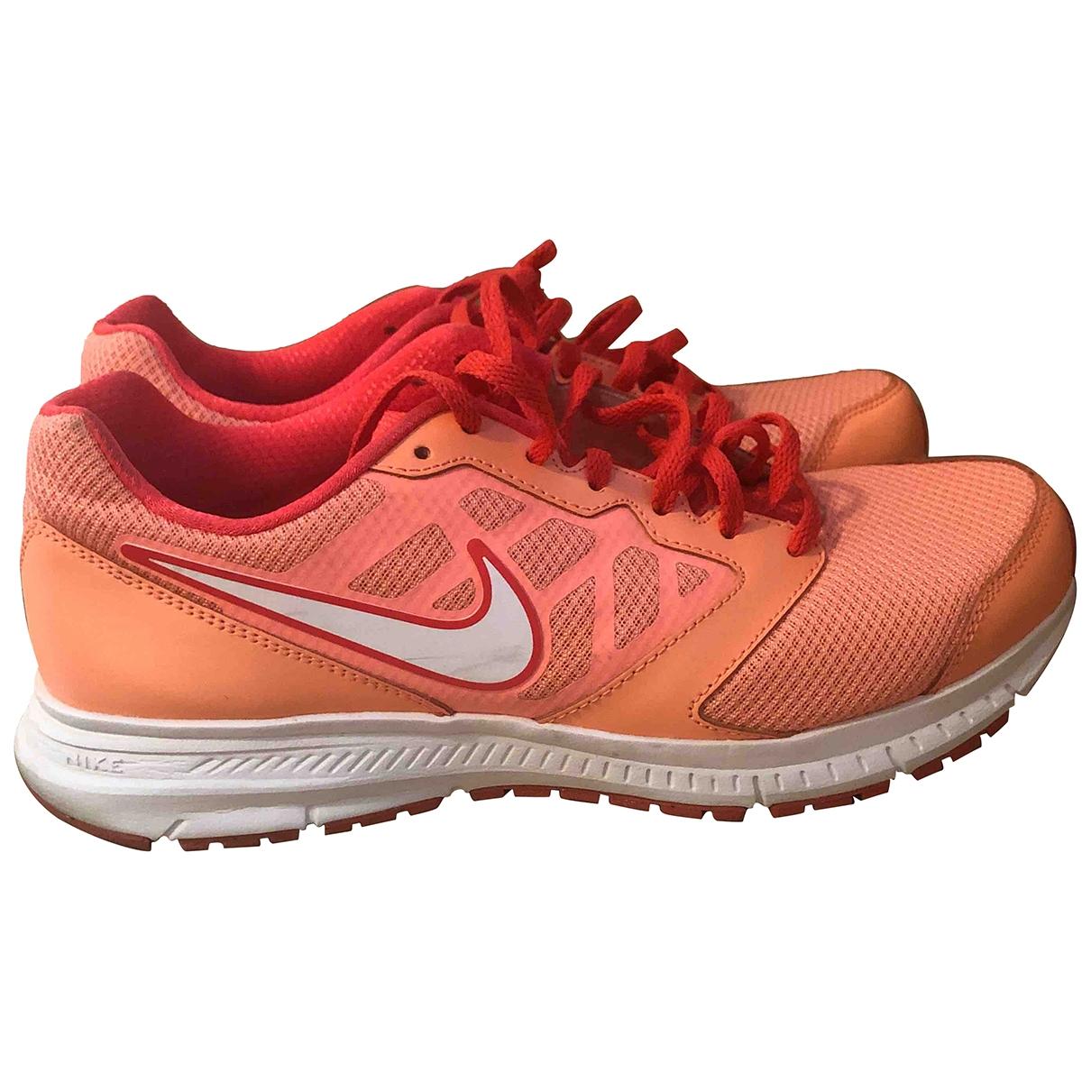Nike - Baskets   pour femme en toile - orange