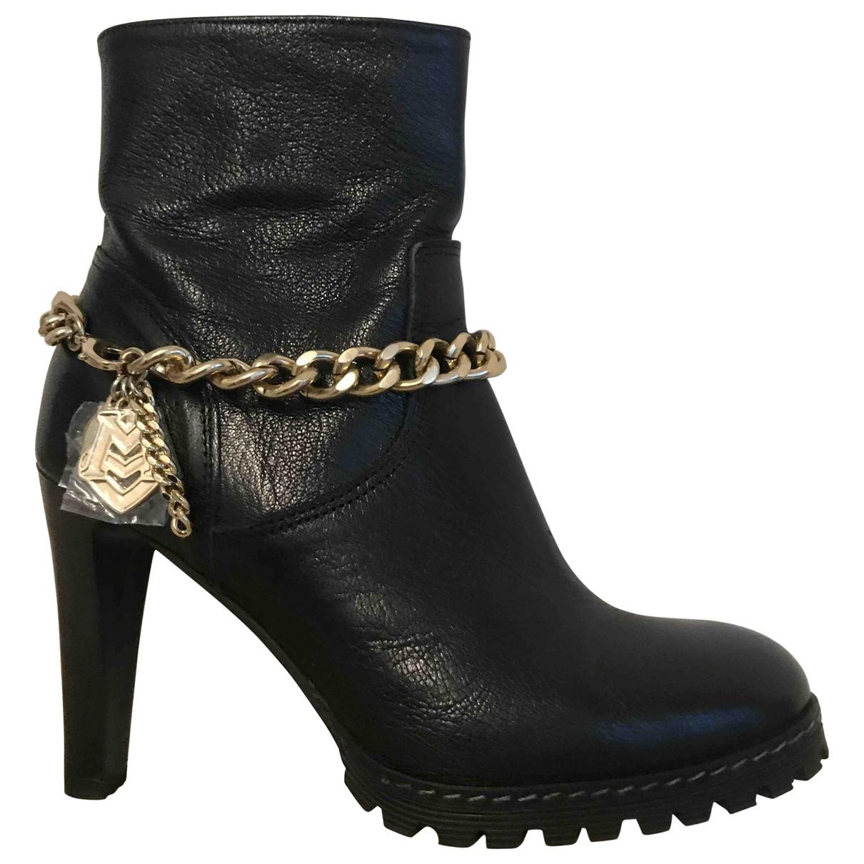 Moschino - Boots   pour femme en cuir - noir