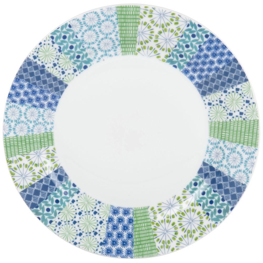 Flacher Teller aus weissem Porzellan mit grafischen Motiven in Blau und Gruen
