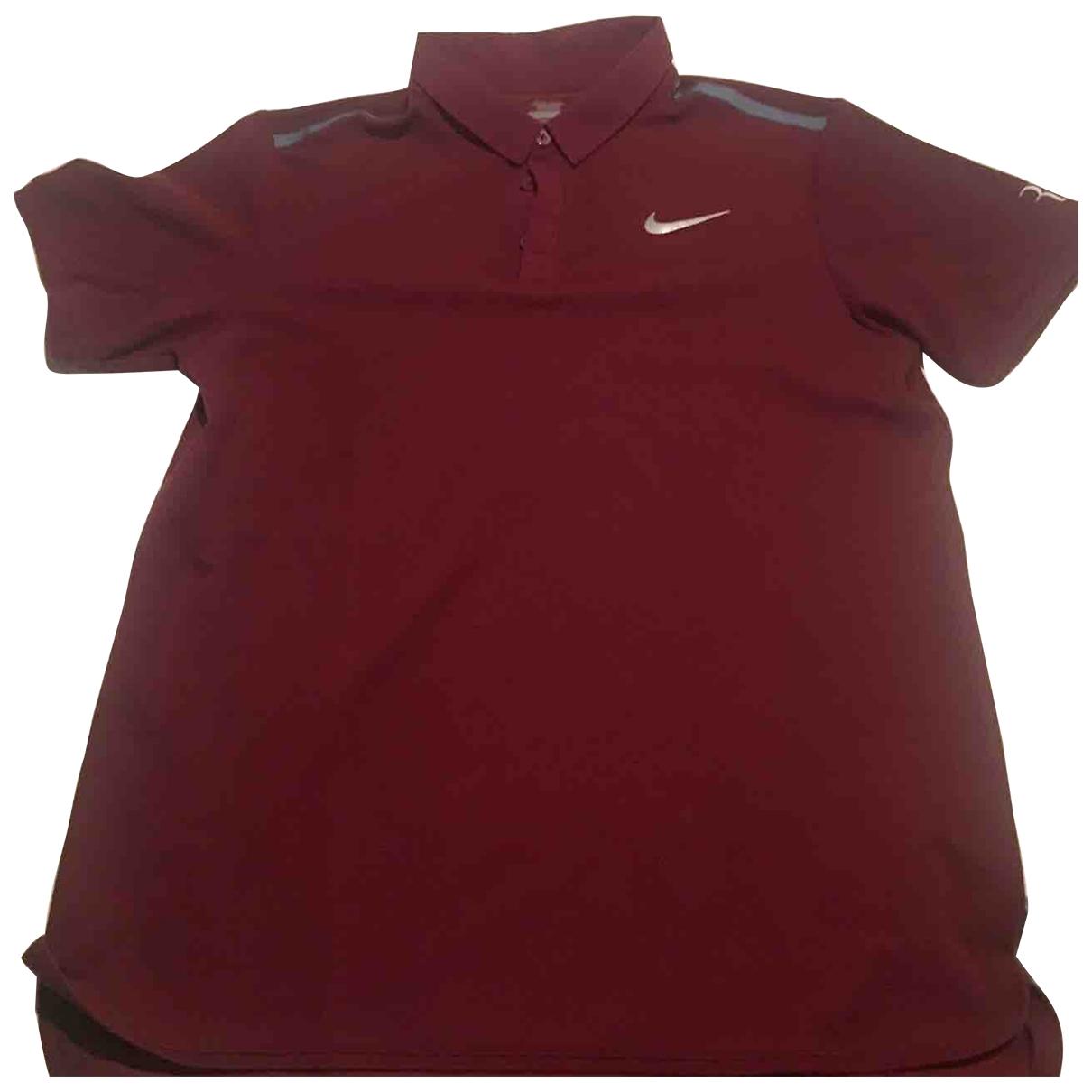 Nike - Polos   pour homme - bordeaux