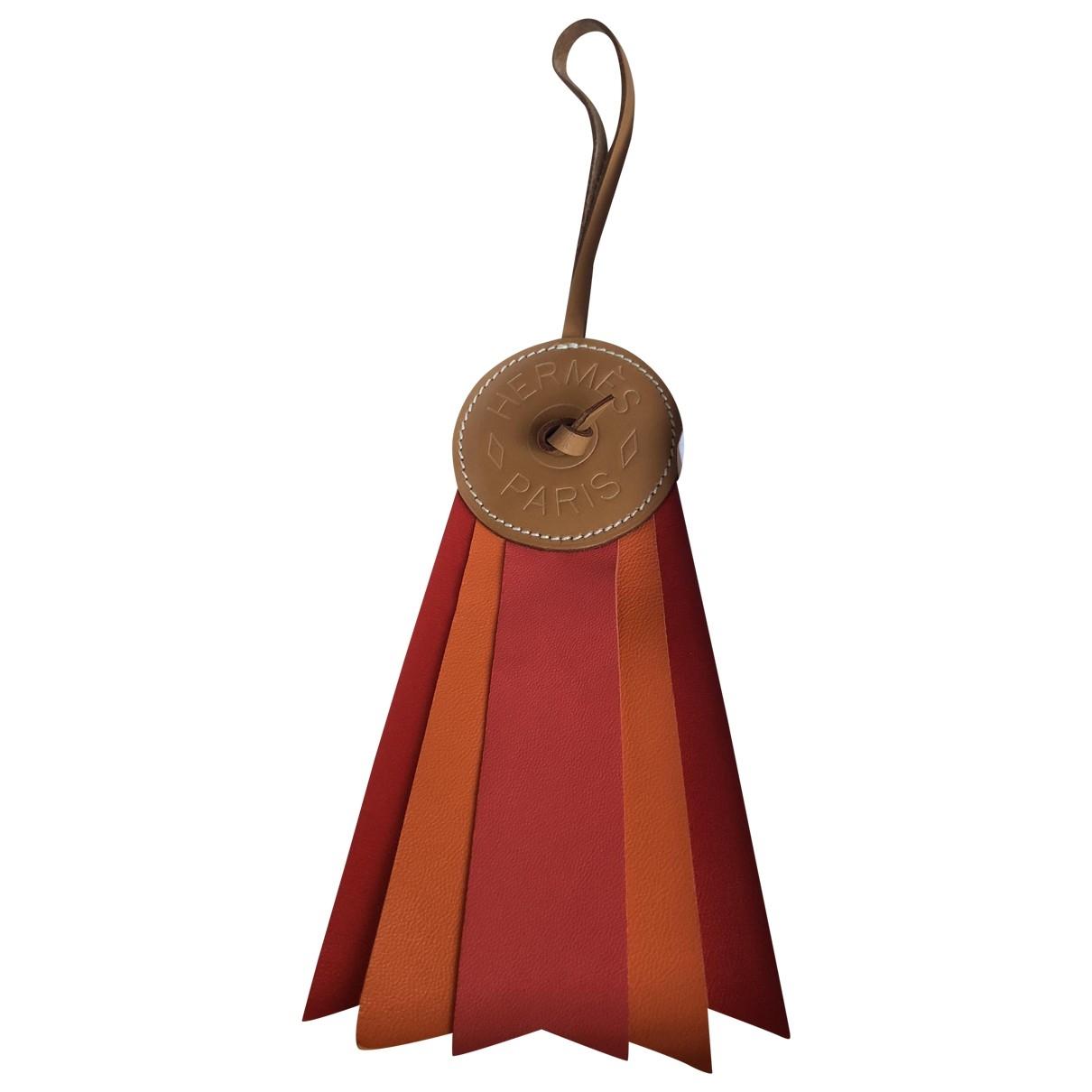 Hermes Paddock Taschenschmuck in  Orange Leder