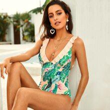 Einteilige rueckenfreie Badebekleidung mit tropischem Muster, Raffung und tiiefem Ausschnitt