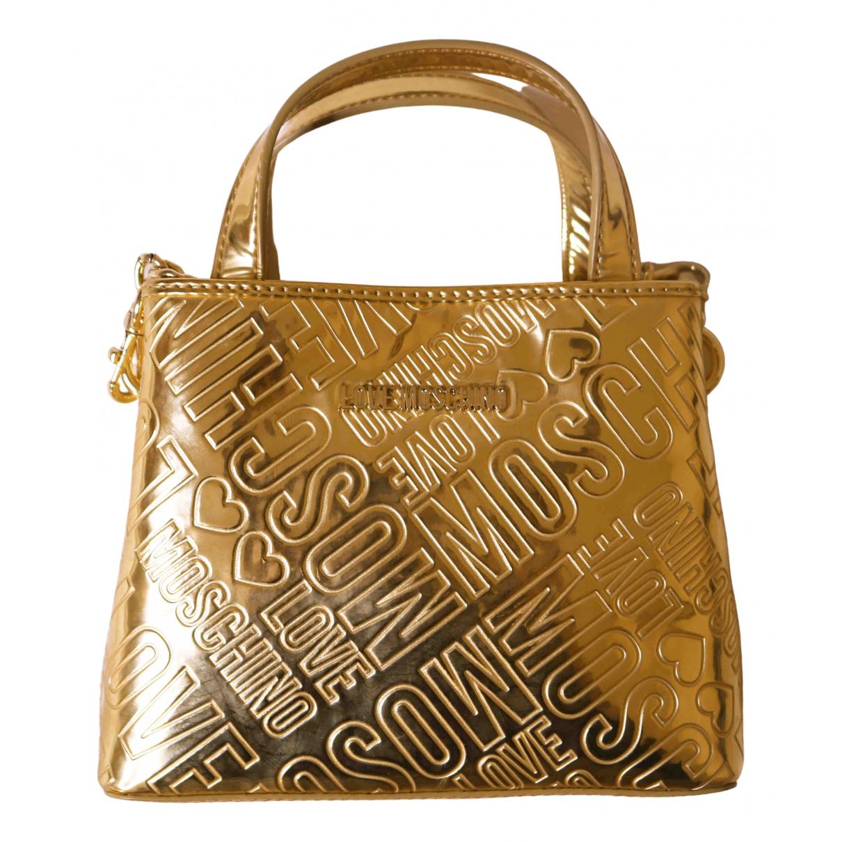 Moschino Love - Sac a main   pour femme en cuir verni - dore