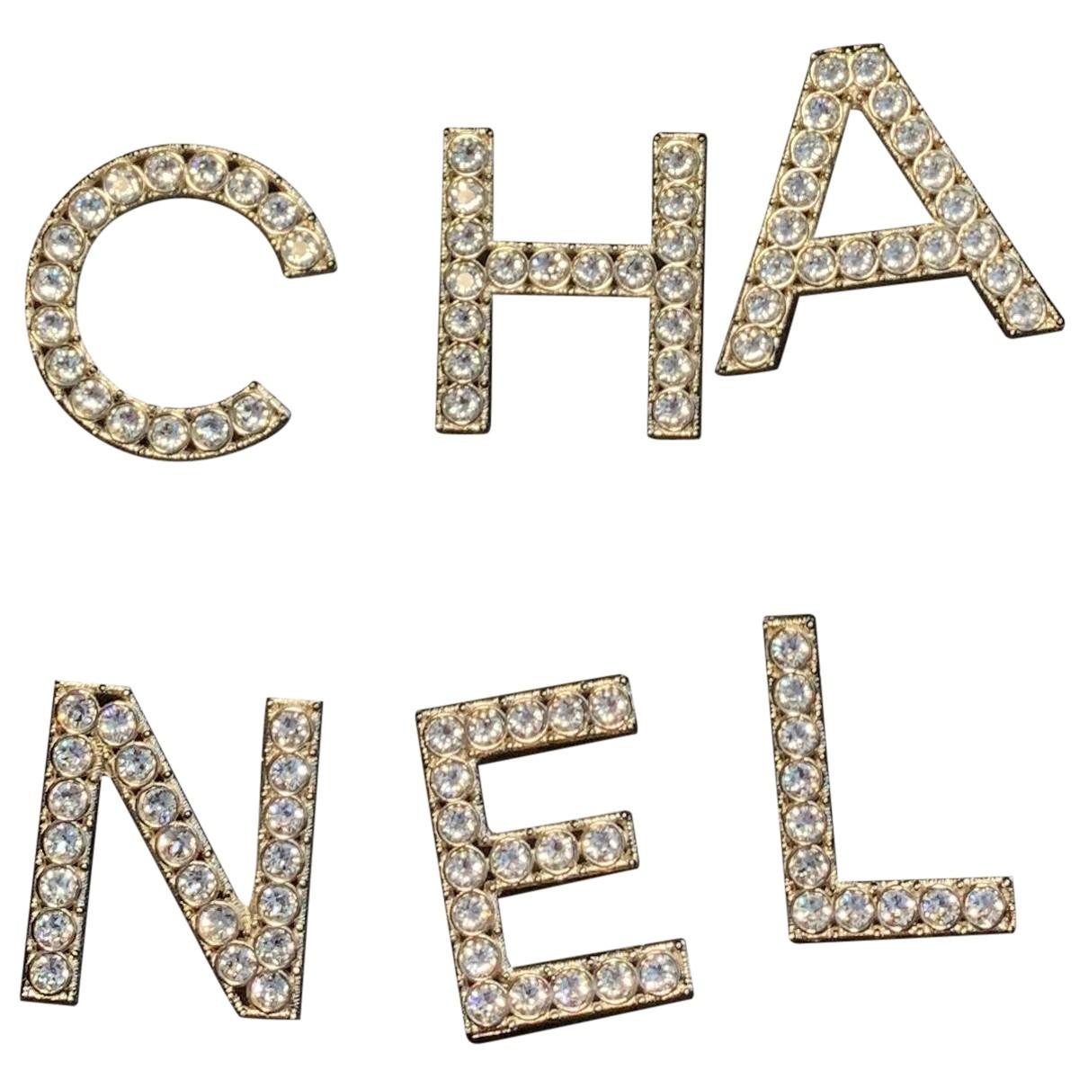 Broche CHANEL en Metal Plateado Chanel