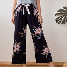 Hose mit Blumen Muster und Band vorn