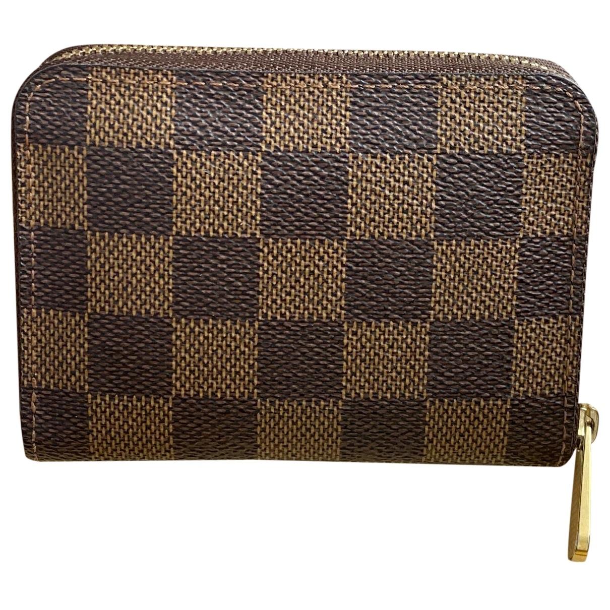 Louis Vuitton - Petite maroquinerie Zippy pour femme en toile - marron