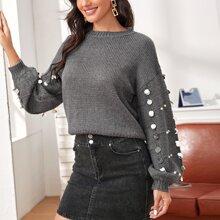 Pullover mit sehr tief angesetzter Schulterpartie, Pailletten und Perlen