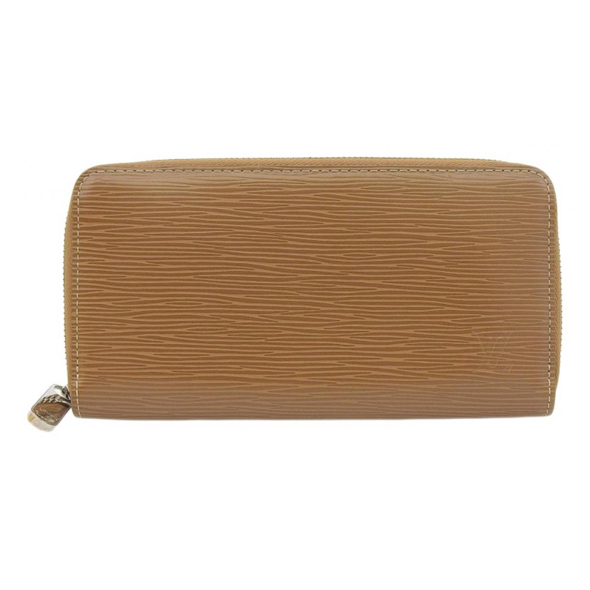 Louis Vuitton - Portefeuille Zippy pour femme en cuir - camel
