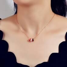 Halskette mit buntem rundem Anhaenger