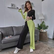 Hose mit Kreuzgurt und breitem Beinschnitt