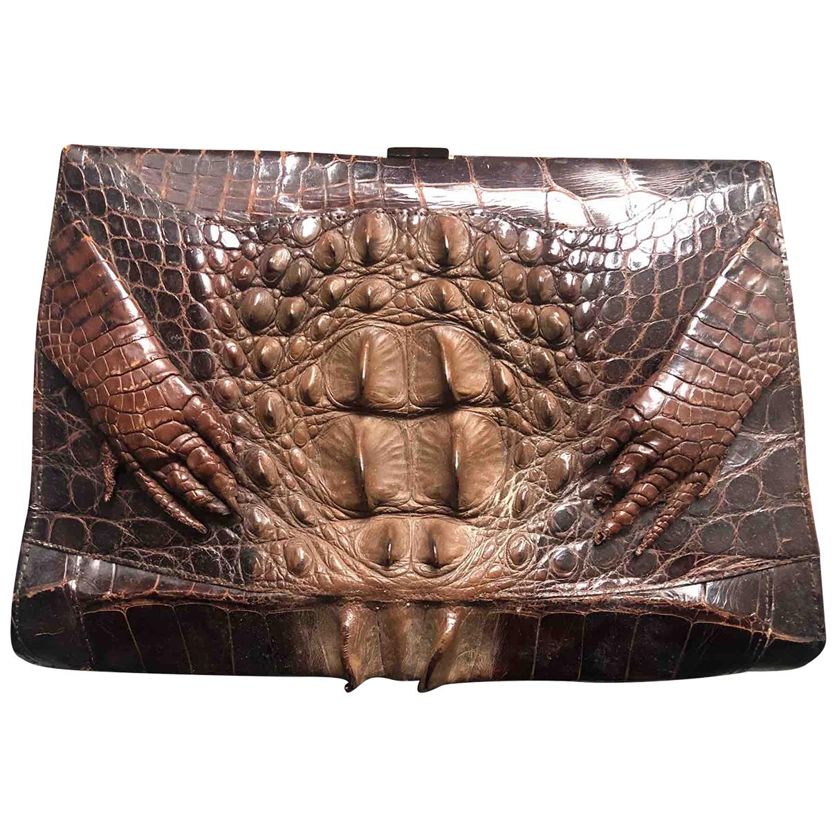 - Pochette   pour femme en cuir exotique - marron